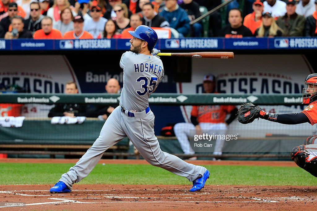 <a gi-track='captionPersonalityLinkClicked' href=/galleries/search?phrase=Eric+Hosmer&family=editorial&specificpeople=7091345 ng-click='$event.stopPropagation()'>Eric Hosmer</a> #35 of the Kansas City Royals hits a RBI double to left field scoring Norichika Aoki #23 and Lorenzo Cain #6 in the first inning against Bud Norris #25 of the Baltimore Orioles during Game Two of the American League Championship Series at Oriole Park at Camden Yards on October 11, 2014 in Baltimore, Maryland.