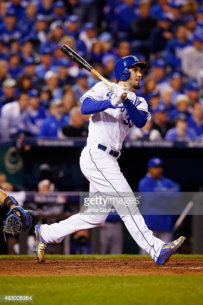 Eric Hosmer of the Kansas City Royals hits an RBI double in the eighth inning against the Toronto Blue Jays during game one of the American League...