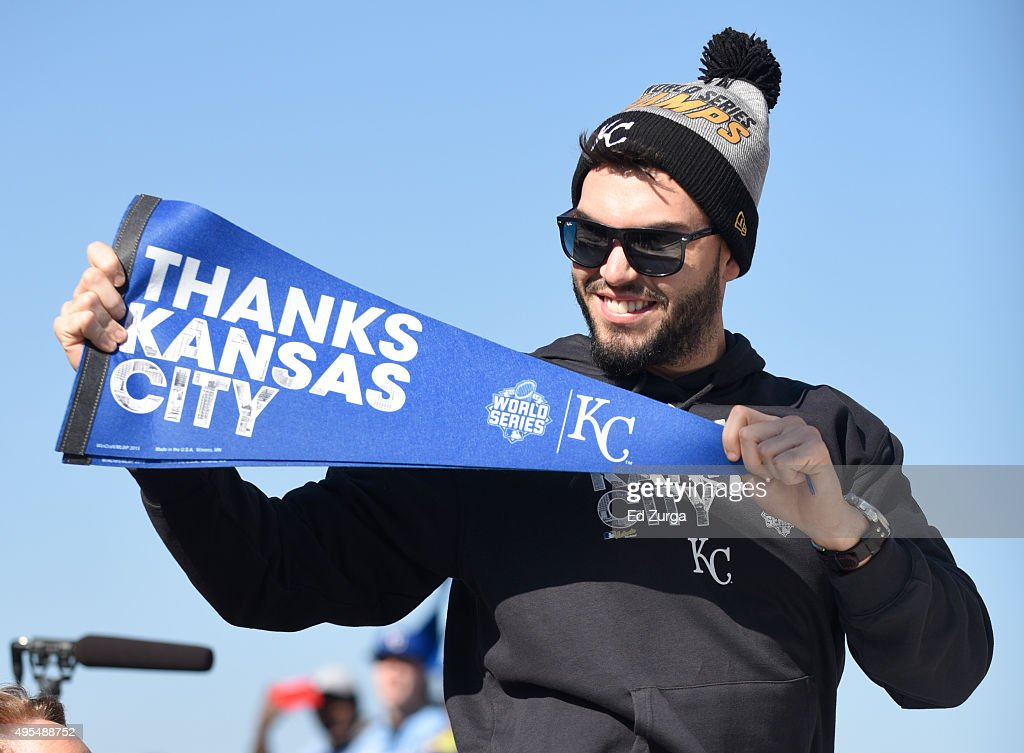 Eric Hosmer #35 of the Kansas City Royals holds up a pennant thanking fans during a parade to celebrate their World Series victory on November 3, 2015 in Kansas City, Missouri.