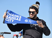 Eric Hosmer of the Kansas City Royals holds up a pennant thanking fans during a parade to celebrate their World Series victory on November 3 2015 in...