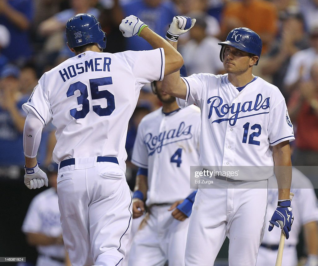 Eric Hosmer #35 of the Kansas City Royals is congratulated by Mitch Maier #12 after hitting a two-run home run during an interleague game against the Milwaukee Brewers in the sixth inning at Kauffman Stadium on June 14, 2012 in Kansas City, Missouri.