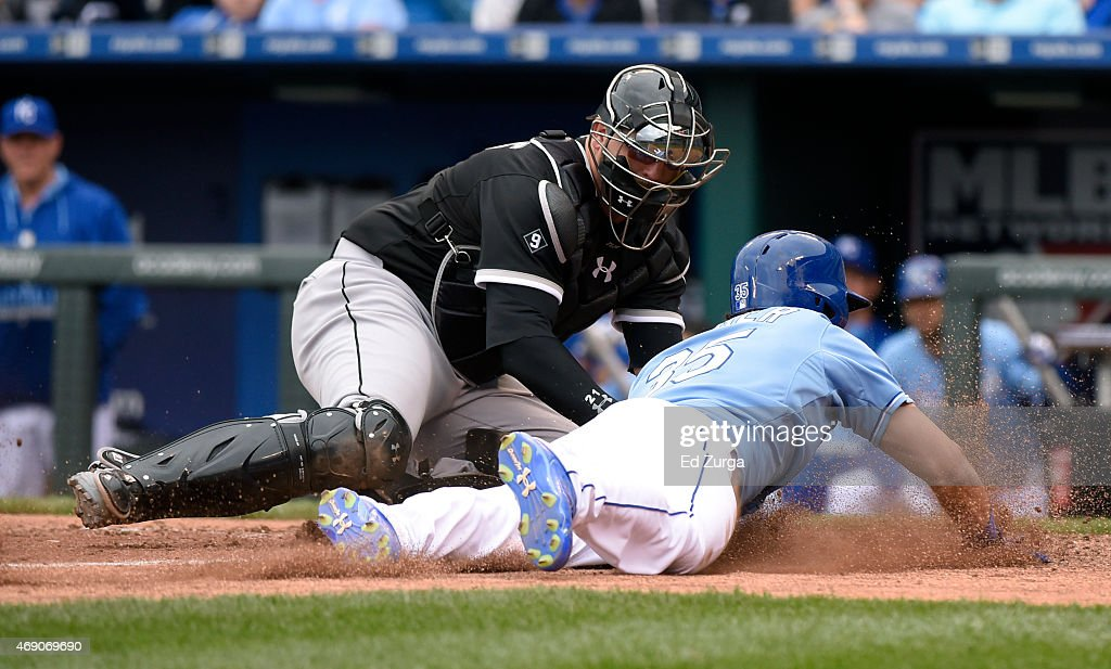 Eric Hosmer #35 of the Kansas City Royals is tagged out by Tyler Flowers #21 of the Chicago White Sox as he tries to score on a fielders' choice in the eighth inning on April 9, 2015 at Kauffman Stadium in Kansas City, Missouri.