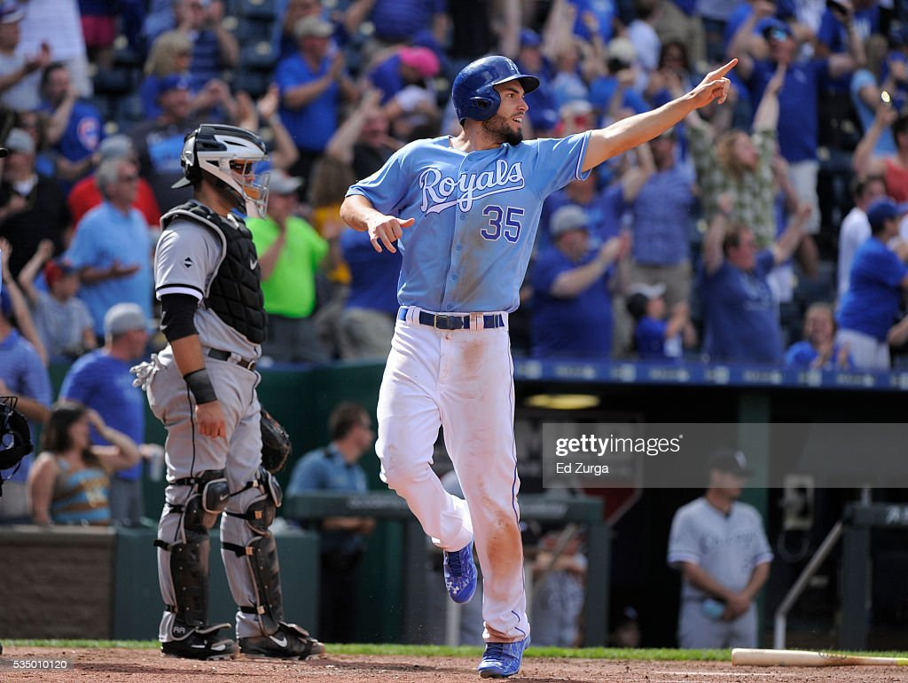Eric Hosmer #35 of the Kansas City Royals points to Drew Butera #9 as he scores on Butera's double in the ninth inning against the Chicago White Sox at Kauffman Stadium on May 28, 2016 in Kansas City, Missouri.