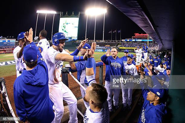 Eric Hosmer of the Kansas City Royals returns to the dugout after scoring in the sixth inning against the San Francisco Giants during Game Two of the...