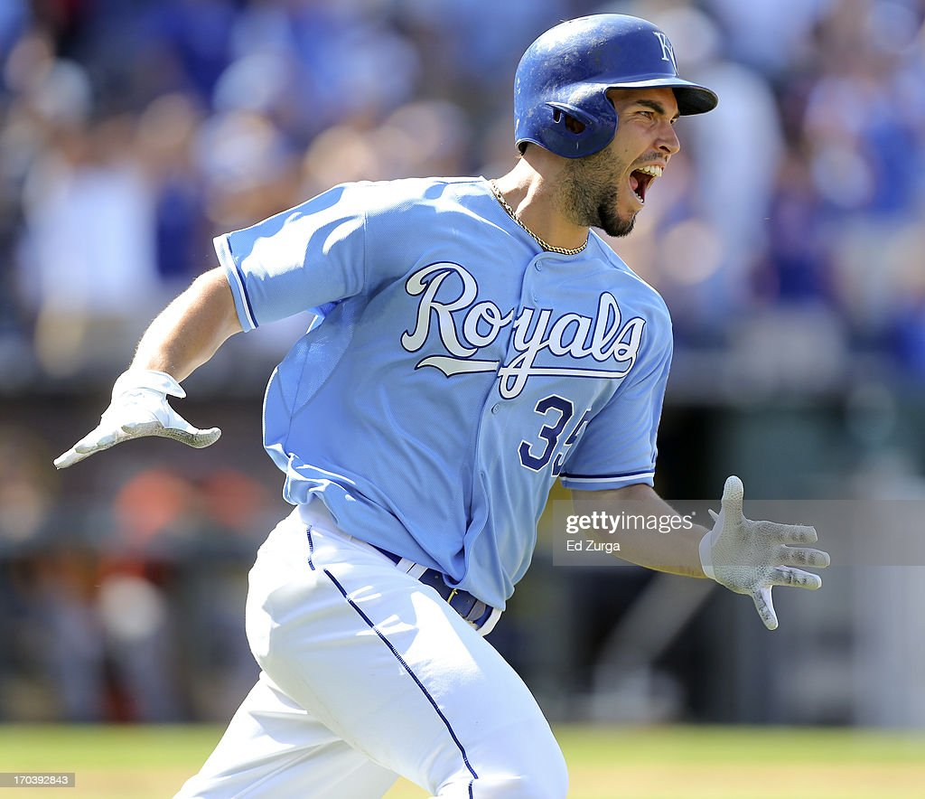 <a gi-track='captionPersonalityLinkClicked' href=/galleries/search?phrase=Eric+Hosmer&family=editorial&specificpeople=7091345 ng-click='$event.stopPropagation()'>Eric Hosmer</a> #35 of the Kansas City Royals rounds first as he celebrates his game-winning RBI single in the 10th inning during a game against the Detroit Tigers at Kauffman Stadium on June 12, 2013 in Kansas City, Missouri. The Royals won 3-2.
