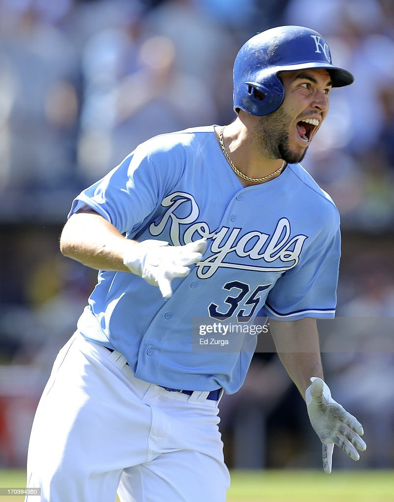 Eric Hosmer #35 of the Kansas City Royals rounds first as he celebrates his game-winning RBI single in the 10th inning during a game against the Detroit Tigers at Kauffman Stadium on June 12, 2013 in Kansas City, Missouri. The Royals won 3-2.