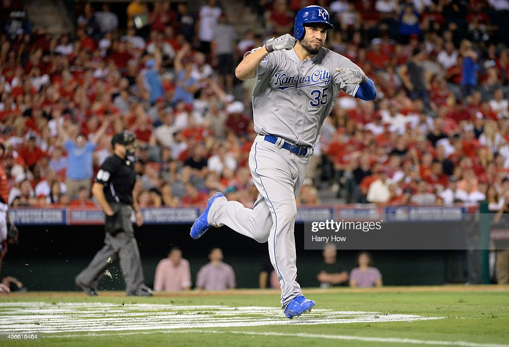 Eric Hosmer of the Kansas City Royals rounds the bases after hitting a tworun home run in the eleventh inning against the Los Angeles Angels during...