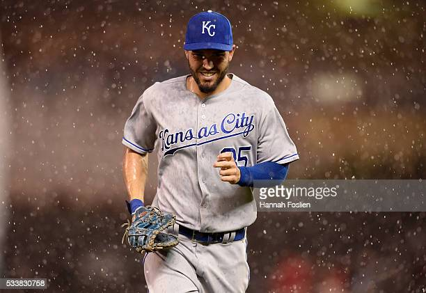 Eric Hosmer of the Kansas City Royals runs off the field as a rain delay is called by second base umpire Jeff Kellogg during the third inning of the...