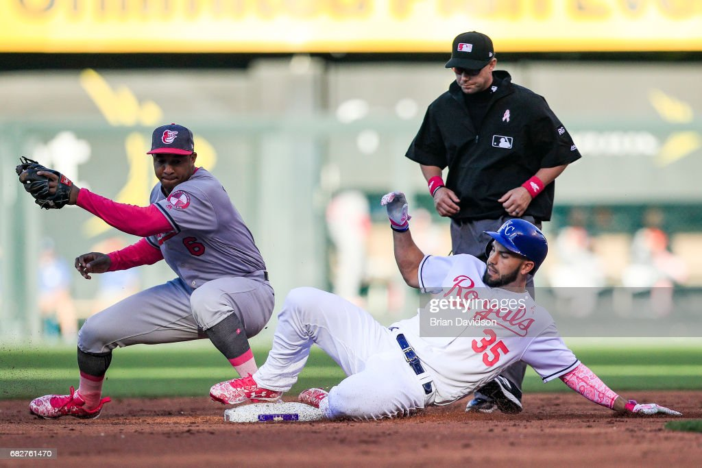 Eric Hosmer #35 of the Kansas City Royals slides into second base under the tag of Jonathan Schoop #6 of the Baltimore Orioles during the second inning at Kauffman Stadium on May 13, 2017 in Kansas City, Missouri. Players are wearing pink to celebrate Mother's Day weekend and support breast cancer awareness.