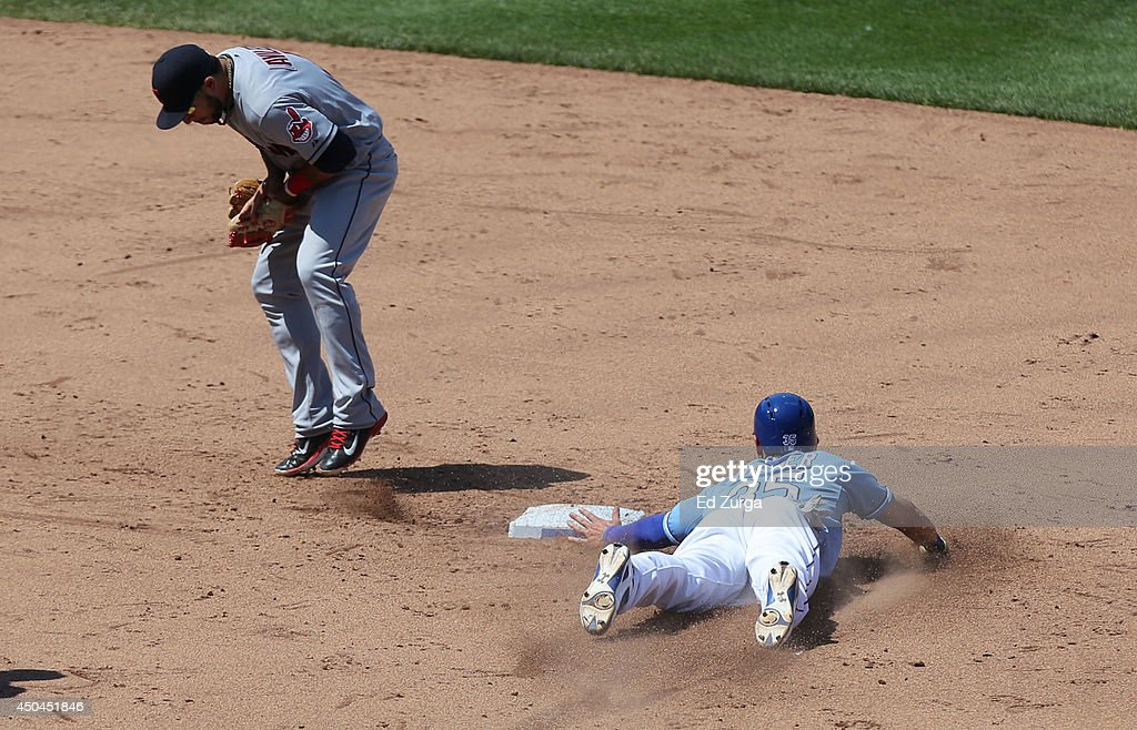 Eric Hosmer #35 of the Kansas City Royals slides into second for a steal as Mike Aviles #4 of the Cleveland Indians fields the throw in the seventh inning at Kauffman Stadium on June 11, 2014 in Kansas City, Missouri.