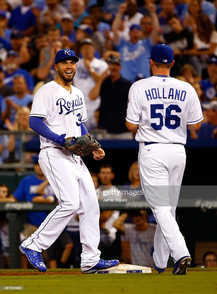 Eric Hosmer #35 of the Kansas City Royals smiles at Greg Holland #56 during the 9th inning of the game against the Minnesota Twins at Kauffman Stadium on September 8, 2015 in Kansas City, Missouri.