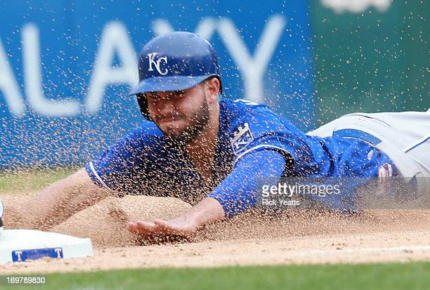 Eric Hosmer of the Kansas City Royals steals third base in the eighth inning against the Texas Rangers at Rangers Ballpark in Arlington on June 1...