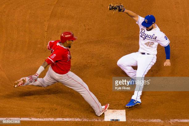 Eric Hosmer of the Kansas City Royals tags out Yunel Escobar of the Los Angeles Angels of Anaheim in the sixth inning at Kauffman Stadium on April 15...