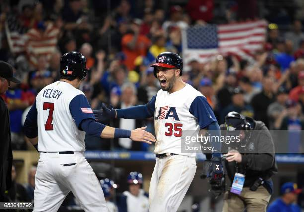 Eric Hosmer of the United States center celebrates with Christian Yelich after hitting a tworun home run in eighth inning of the World Baseball...