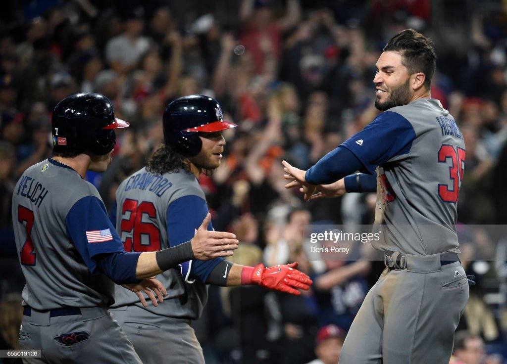 Eric Hosmer #35 of the United States, right, is congratulated by Brandon Crawford #26, and Christian Yelich #7 after scoring during the eighth inning of the World Baseball Classic Pool F Game Six between the United States and the Dominican Republic at PETCO Park on March 18, 2017 in San Diego, California.