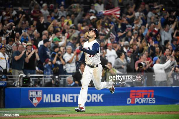Eric Hosmer of the United States rounds the bases after hitting a tworun home run in eighth inning of the World Baseball Classic Pool F Game Two...