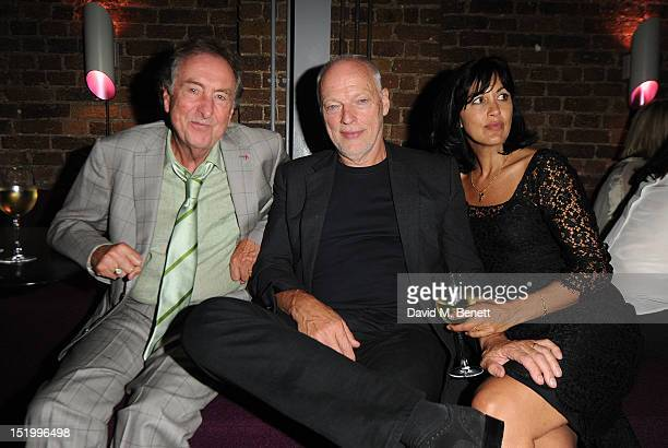 Eric Idle David Gilmour and Polly Samson attends the launch of 'Joseph Anton' by Salman Rushdie at The Collection on September 14 2012 in London...