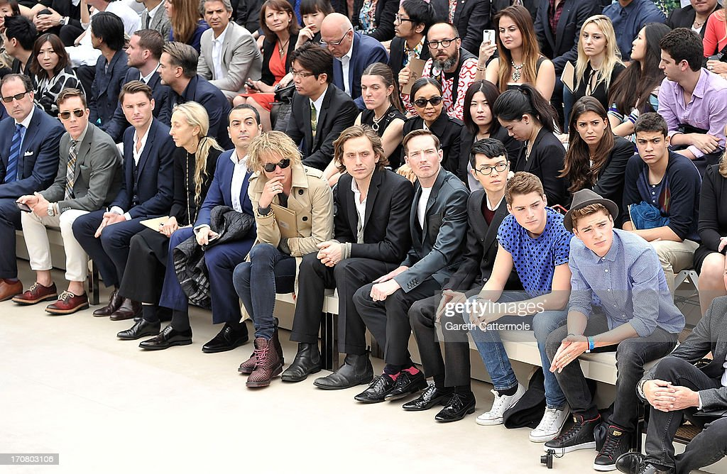 Eric Jennings, Jay Bell,David Fisher, Neil Clifford, Carla Sozzani, Mohammed al Turki, Jamie Campbell Bower, Dan Gillespie Sells, Khalil Fong, Finn Harries and Jack Harries sit in the front row at Burberry Menswear Spring/Summer 2014 at Kensington Gardens on June 18, 2013 in London, England.