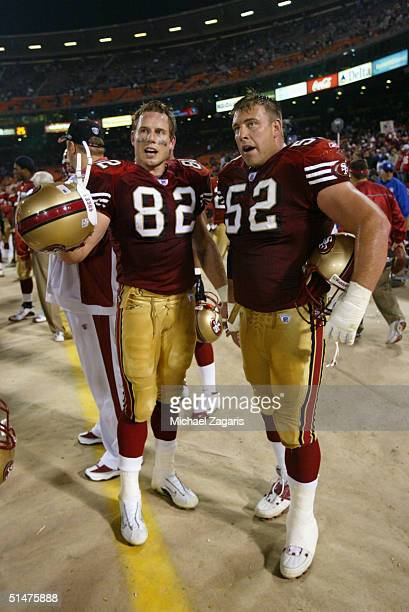 Eric Johnson and Brock Gutierrez of the San Francisco 49ers talk on the sideline during the game against the St Louis Rams at Monster Park on October...