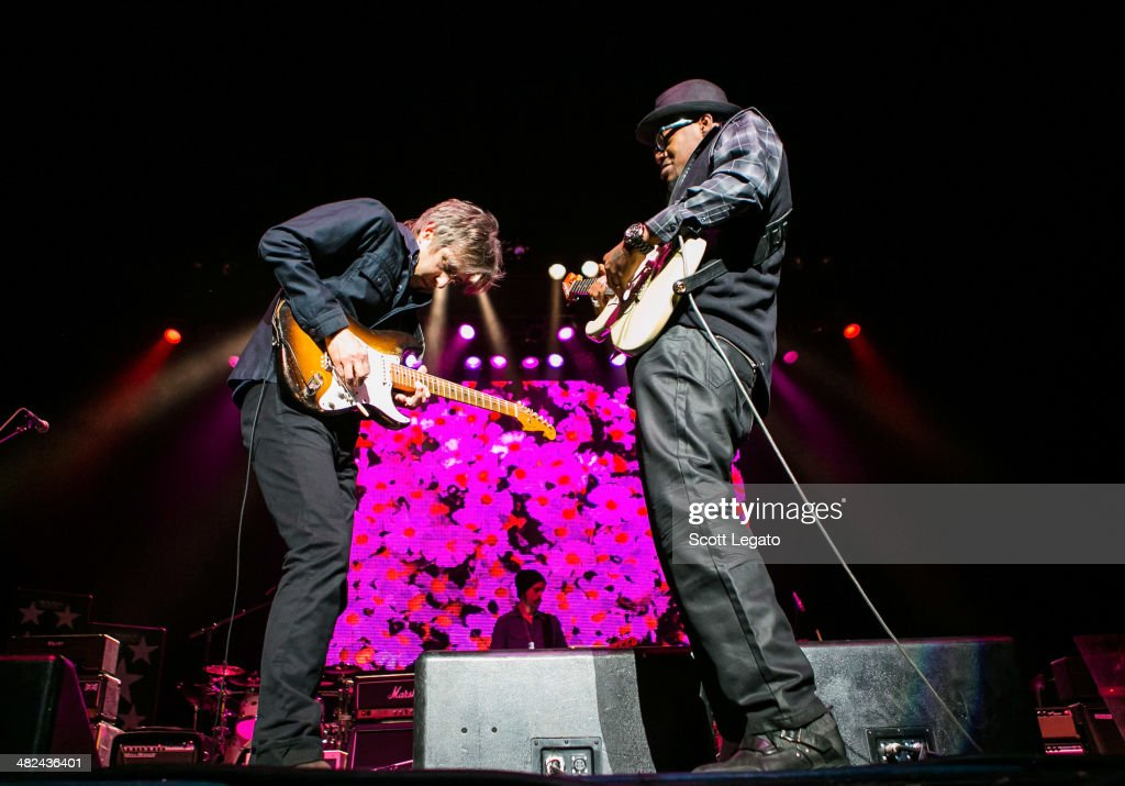 Eric Johnson (L) and Eric Gayles performs during the Experience Hendrix 2014 Tour at The Fox Theatre on April 3, 2014 in Detroit, Michigan.