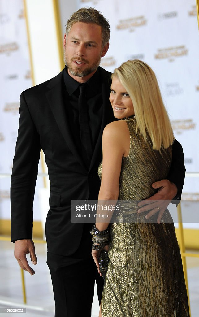 Eric Johnson and Jessica Simpson arrive for the Premiere Of Lionsgate's 'The Hunger Games Mockingjay Part 1' Arrivals held at Nokia Theatre LA Live...