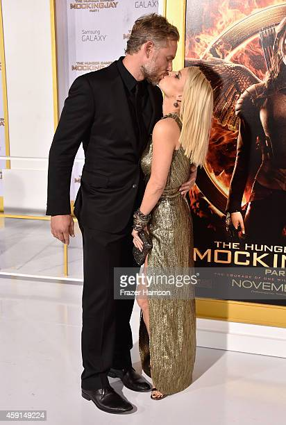 Eric Johnson and Jessica Simpson attend the premiere of Lionsgate's 'The Hunger Games Mockingjay Part 1' at Nokia Theatre LA Live on November 17 2014...