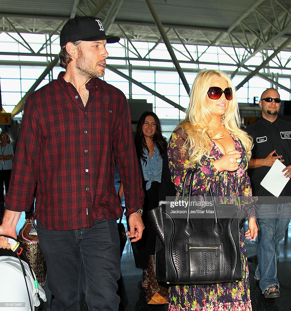 Eric Johnson and <a gi-track='captionPersonalityLinkClicked' href=/galleries/search?phrase=Jessica+Simpson&family=editorial&specificpeople=171513 ng-click='$event.stopPropagation()'>Jessica Simpson</a> depart JFK Airport on September 11, 2012 in New York City.