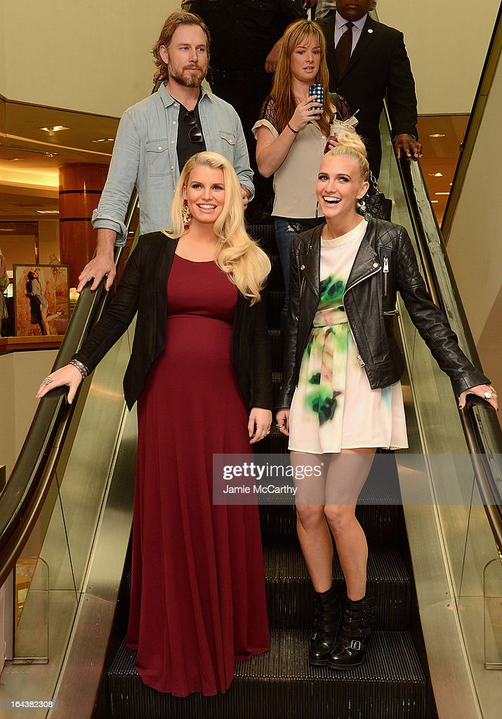 Eric Johnson, Jessica Simpson, wearing Jessica Simpson Maternity, and Ashlee Simpson, wearing a Jessica Simpson dress, visit Belk Southpark on March 23, 2013 in Charlotte, North Carolina.