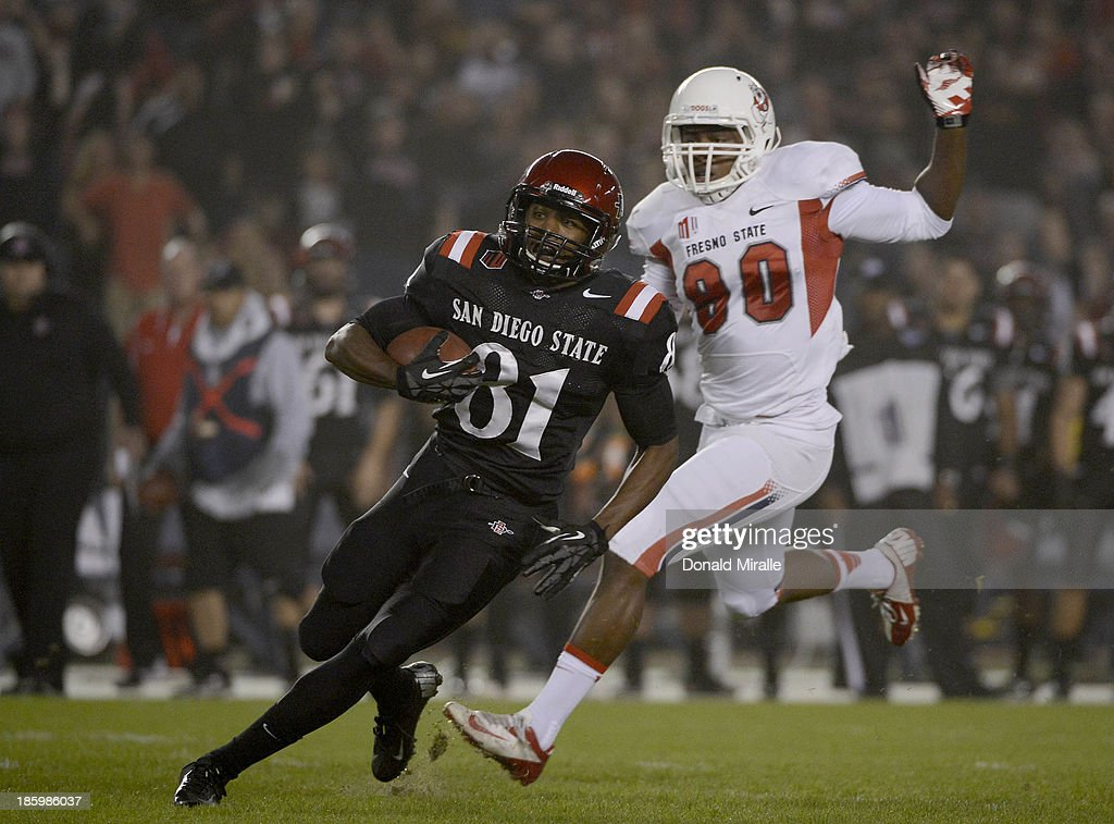 Eric Judge #81 of San Diego State Aztecs runs after the catch against the Fresno State Bulldogs during their game on October 26, 2013 at Qualcomm Stadium in San Diego, California.