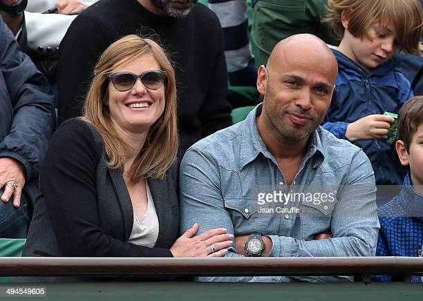 Eric Judor and his girlfriend attend Day 5 of the French Open 2014 held at RolandGarros stadium on May 29 2014 in Paris France