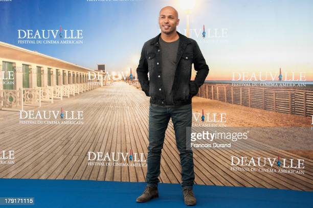 Eric Judor poses at a photocall for the film 'Wrong Cops' during the 39th Deauville American film festival on September 1 2013 in Deauville France