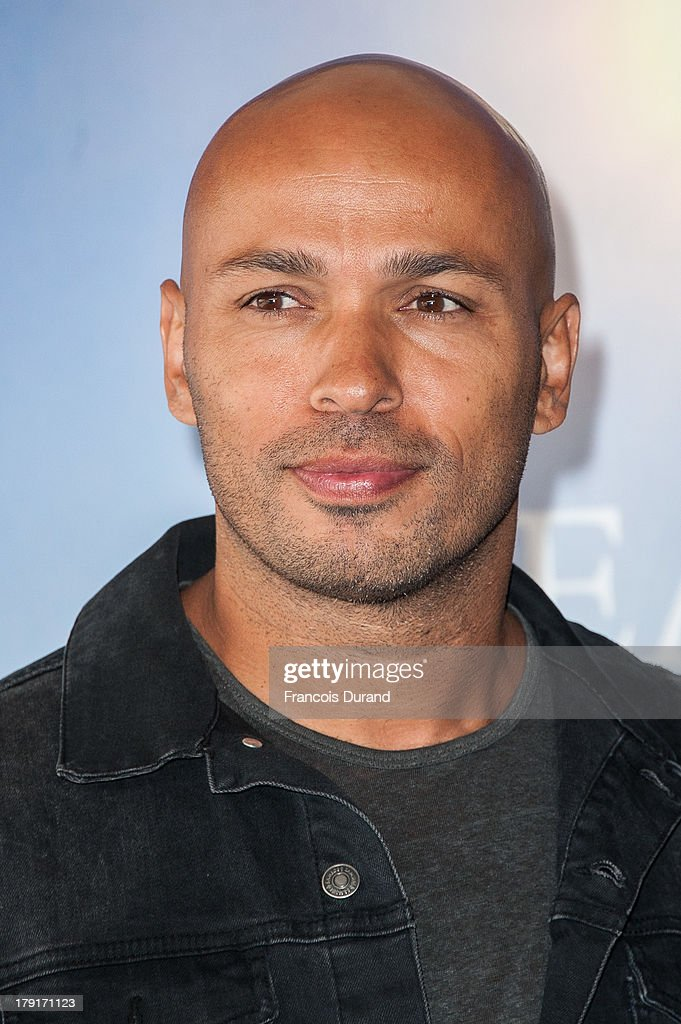 Eric Judor poses at a photocall for the film 'Wrong Cops' during the 39th Deauville American film festival on September 1, 2013 in Deauville, France.