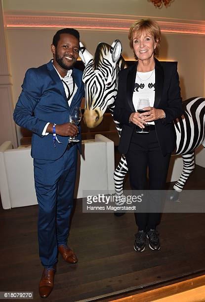 Eric Kabongo and Ulrike Kriener during the 'Willkommen bei den Hartmanns' after party at Palais Lenbach on October 25 2016 in Munich Germany