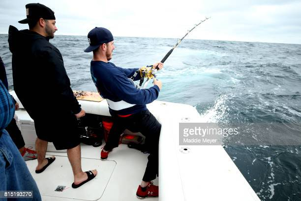 Eric Kelly reels in a short fin mako shark with help from his brother in law Jon Houser during the North Atlantic Monster Shark Tournament on July 14...