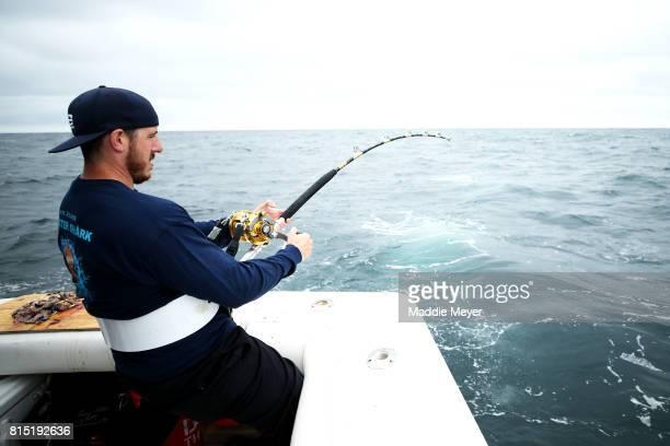 Eric Kelly reels in a shortfin mako shark during the North Atlantic Monster Shark Tournament on July 14 2017 in New Bedford Massachusetts The annual...