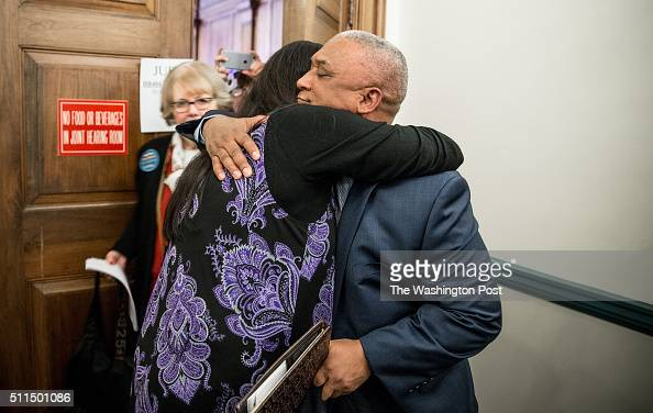 Eric King a right to die advocate and minister from Baltimore whose wife died of breast cancer gets a hug from Kelly Lange who has late stage breast...