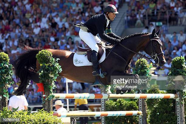 Eric Lamaze of Canada rides on Hickstead and celebrates his victory of the Rolex Grand Prix Jumping competition of the CHIO on July 18 2010 in Aachen...