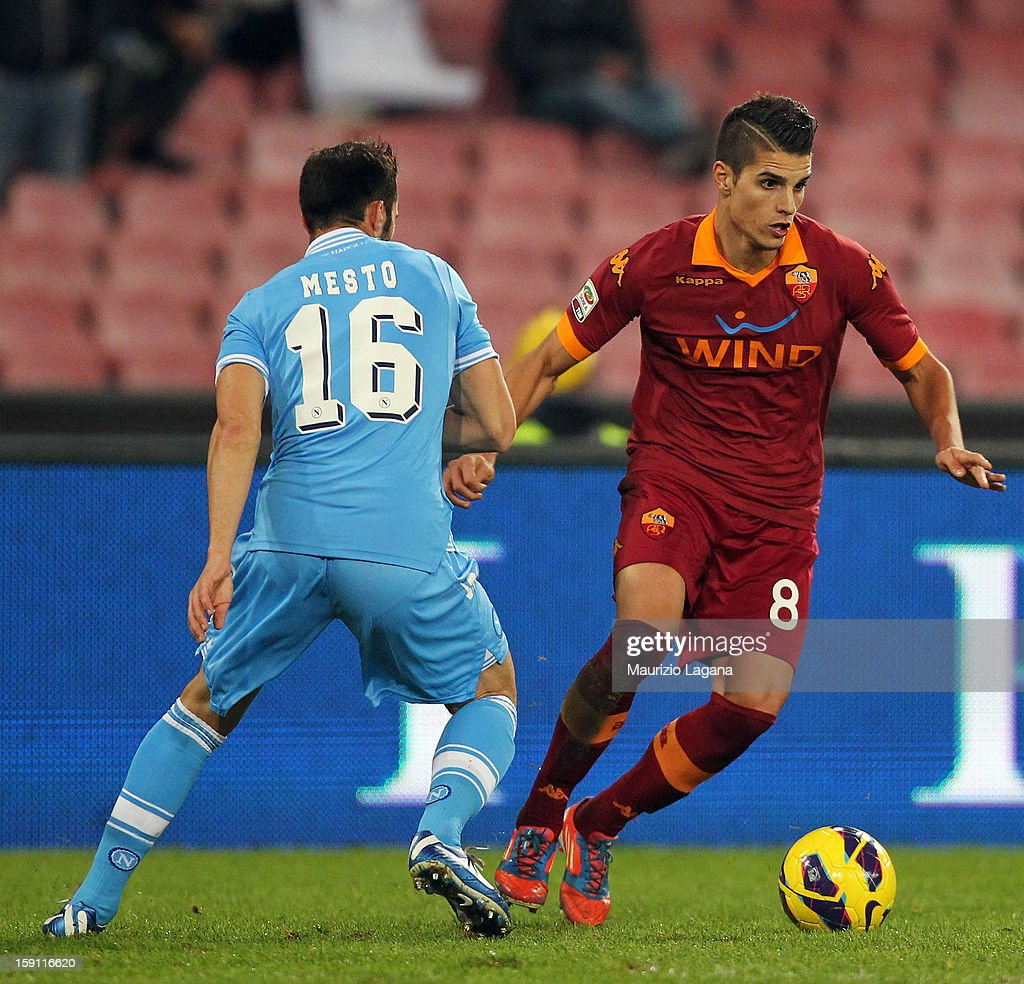 Eric Lamela (R) of Roma competes for the ball with Giandomenico Mesto of Napoli during the Serie A match between SSC Napoli and AS Roma at Stadio San Paolo on January 6, 2013 in Naples, Italy.