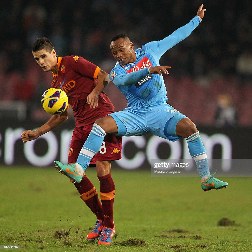 Eric Lamela (L) of Roma competes for the ball with Juan Camilo Zuniga of Napoli during the Serie A match between SSC Napoli and AS Roma at Stadio San Paolo on January 6, 2013 in Naples, Italy.