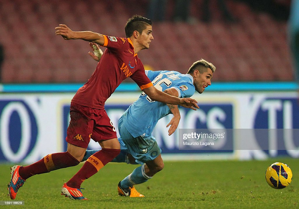 Eric Lamela (L) of Roma competes for the ball with Valon Behrami of Napoli during the Serie A match between SSC Napoli and AS Roma at Stadio San Paolo on January 6, 2013 in Naples, Italy.