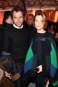 Eric Lartigau and Marina Fois attend the Louis Vuitton show as part of the Paris Fashion Week Womenswear Fall/Winter 20142015 on March 5 2014 in...