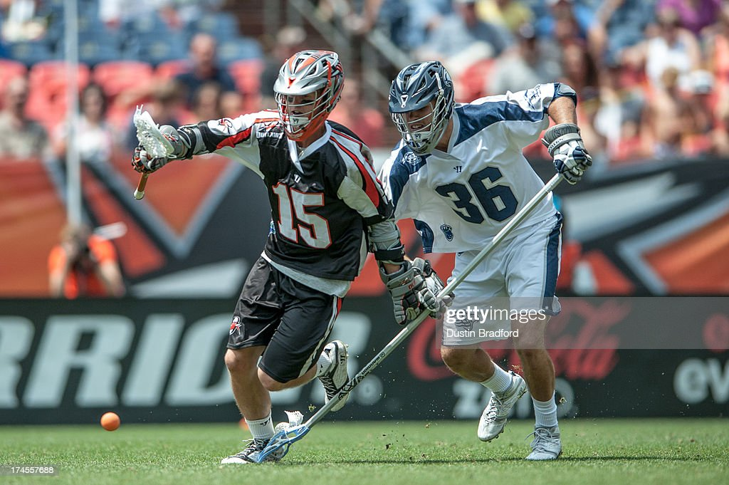 Eric Law #15 of the Denver Outlaws and Jesse Bernhardt #36 of the Chesapeake Bayhawks chase down a loose ball in the second half during a Major League Lacrosse game at Sports Authority Field at Mile High on July 27, 2013 in Denver, Colorado. The Outlaws beat the Bayhawks 14-12.