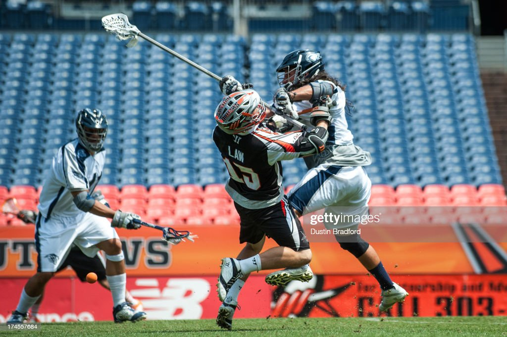 Eric Law #15 of the Denver Outlaws is knocked off his feet and has the ball knocked loose by Brian Spallina #91 of the Chesapeake Bayhawks during a Major League Lacrosse game at Sports Authority Field at Mile High on July 27, 2013 in Denver, Colorado. The Outlaws beat the Bayhawks 14-12.