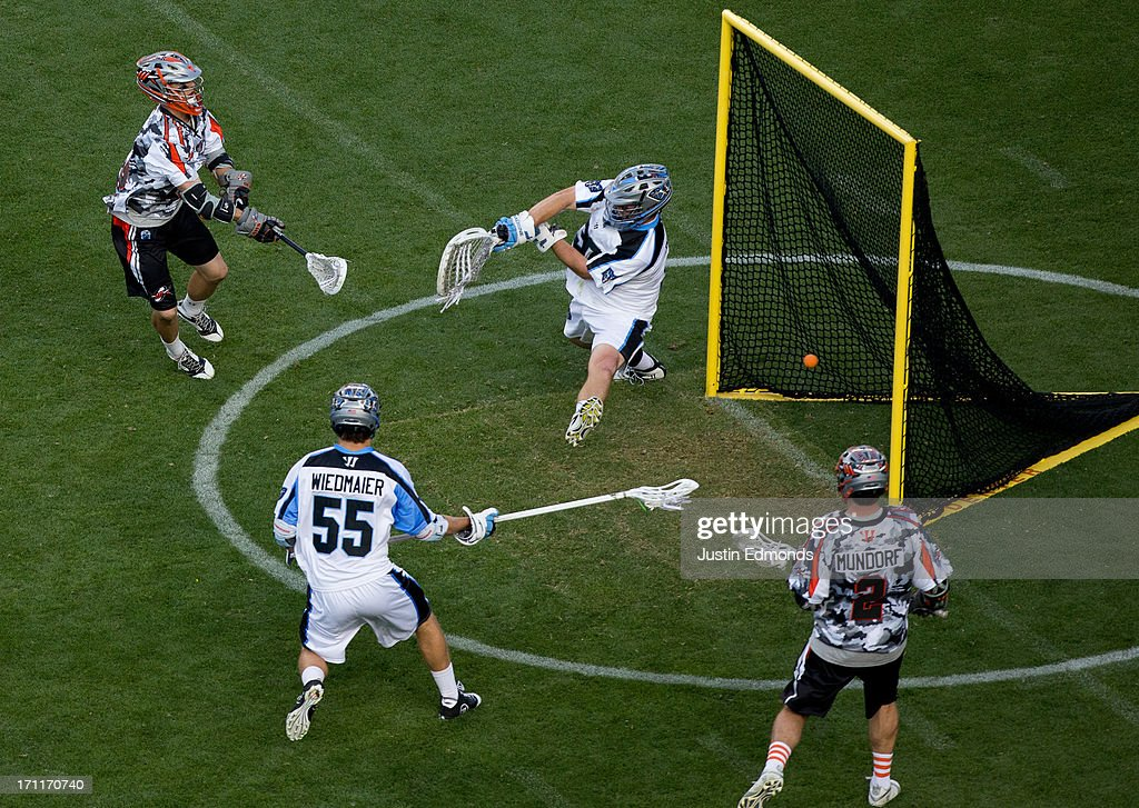 Eric Law #15 of the Denver Outlaws scores past Brian Phipps #30 of the Ohio Machine as Chad Wiedmaier #55 and <a gi-track='captionPersonalityLinkClicked' href=/galleries/search?phrase=Brendan+Mundorf&family=editorial&specificpeople=5984390 ng-click='$event.stopPropagation()'>Brendan Mundorf</a> #2 look on during the second quarter at Sports Authority Field at Mile High on June 22, 2013 in Denver, Colorado.