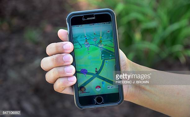 Eric Lee displays the game Pokemon Go on his cellphone on July 13 2016 in San Gabriel California where he and friends were playing at the San Gabriel...