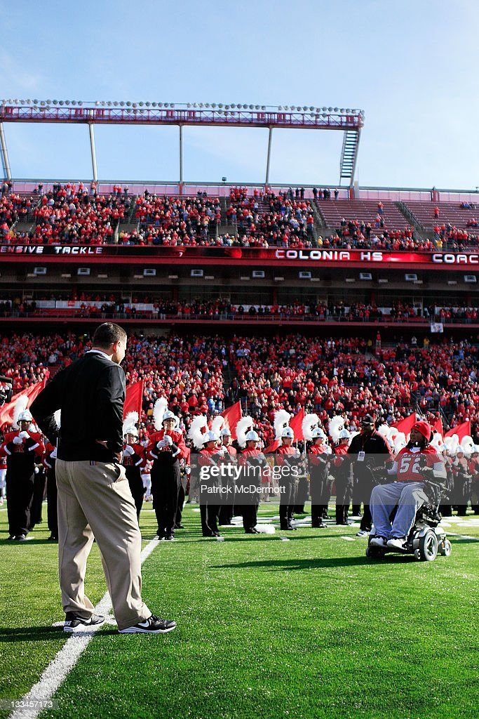Eric LeGrand of the Rutgers Scarlet Knights enters the stadium to be honored on Senior's Day at center field with head coach Greg Schiano of the...