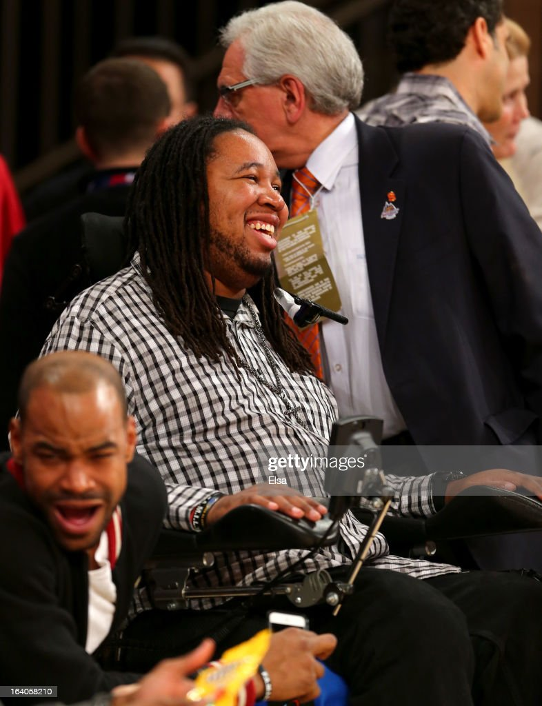 Eric LeGrand watches the Louisville Cardinals play the Syracuse Orange during the final of the Big East Men's Basketball Tournament at Madison Square Garden on March 16, 2013 in New York City.