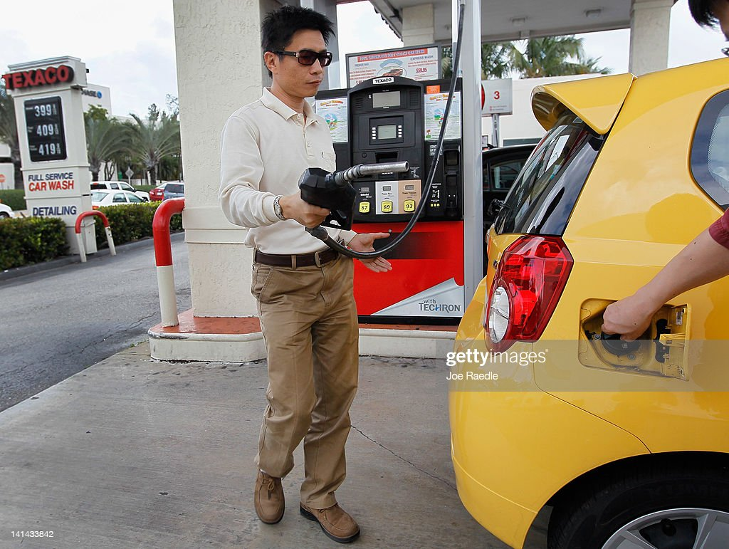Eric Lian prepares to put fuel in his car at a gas station on March 16, 2012 in Miami Beach, Florida. Reports indicate that the consumer price index rose 0.4 percent in February, the largest increase in 10 months. Gas prices rose 6 percent to account for most of the gain.