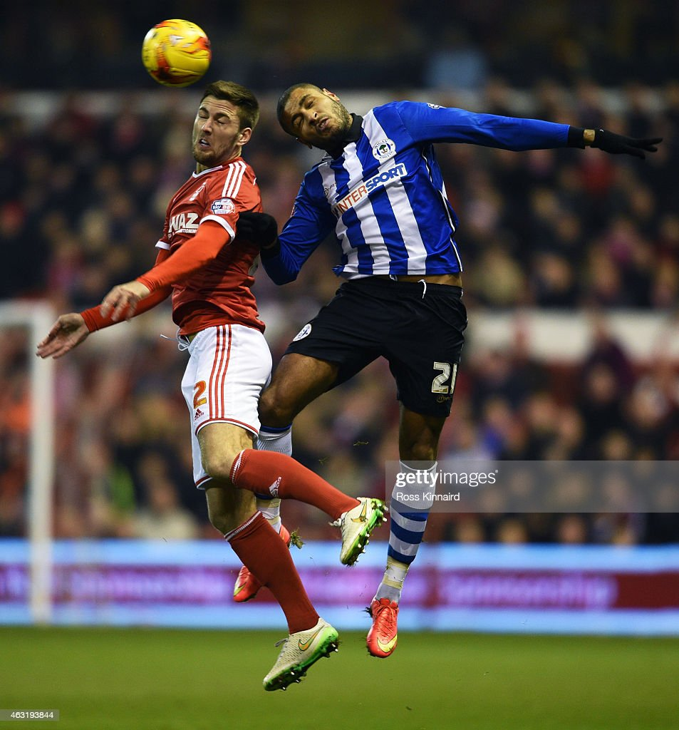 Eric Lichaj of Nottingham Forest and Ivan Ramis of Wigan Athletic compete for a header during the Sky Bet Championship match between Nottingham...