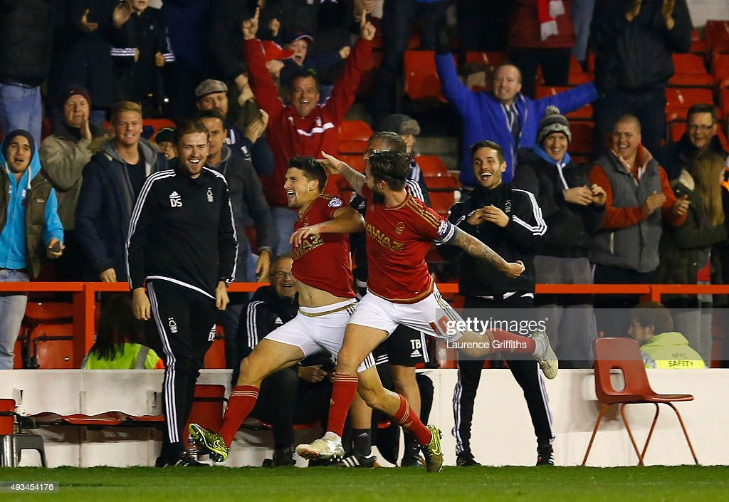 Eric Lichaj of Nottingham Forest celebrates his goal with Henri Lansbury during the Sky Bet Championship match between Nottingham Forest and Burnley at City Ground on October 20, 2015 in Nottingham, England.